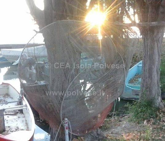 Tramonto fra reti e barche dei pescatori di San Feliciano